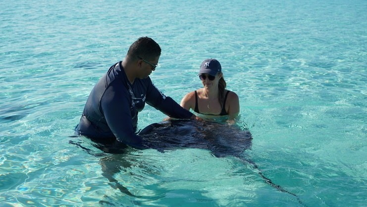 Two people holding a stingray
