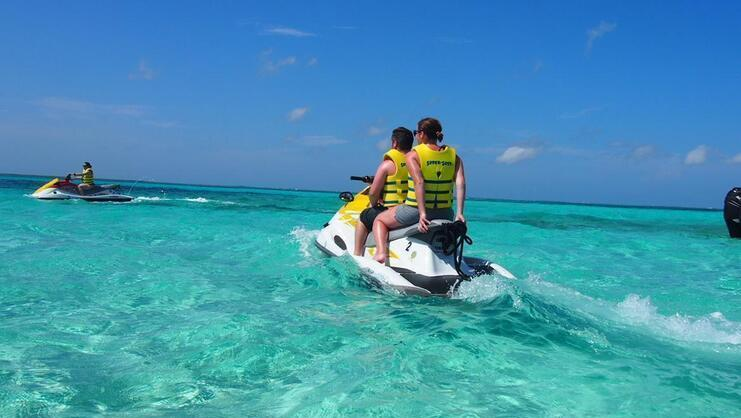 two people on a jet ski at Stingray City