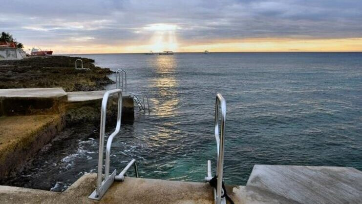 picture of ladder going into the sea