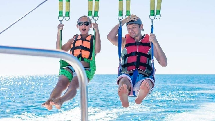 picture of two people parasailing
