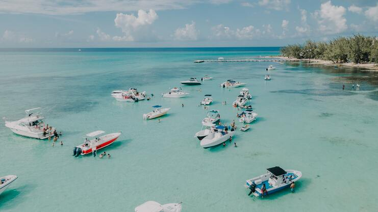 aerial image showing 15 boats and people at rum point