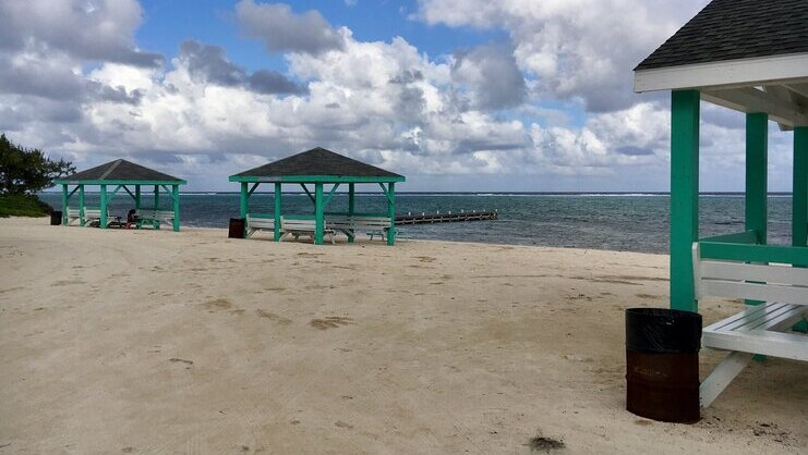 picture of beach with cabanas
