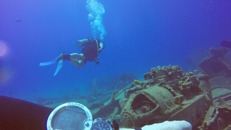 picture of diver above shipwreck