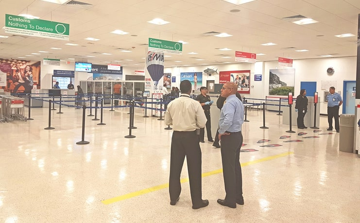 picture of officers standing in cayman airport customs area